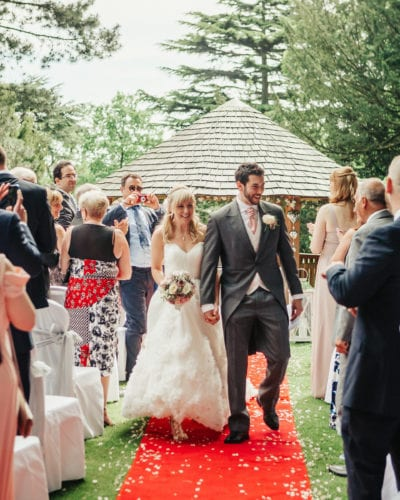 laughing confetti red carpet outdoor ceremony